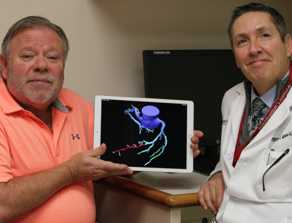 A patient and a doctor show heartflow app in a tablet